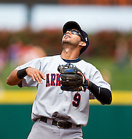 Renny Osuna (9) of the Arkansas Travelers eyes a fly ball to the infield during a game against the Springfield Cardinals at Hammons Field on May 8, 2012 in Springfield, Missouri. (David Welker/ Four Seam Images)