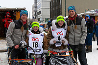 Iditarider and family pose with their musher at 4th Avenue and D street in downtown Anchorage, Alaska on Saturday March 7th during the 2020 Iditarod race. Photo copyright by Cathy Hart