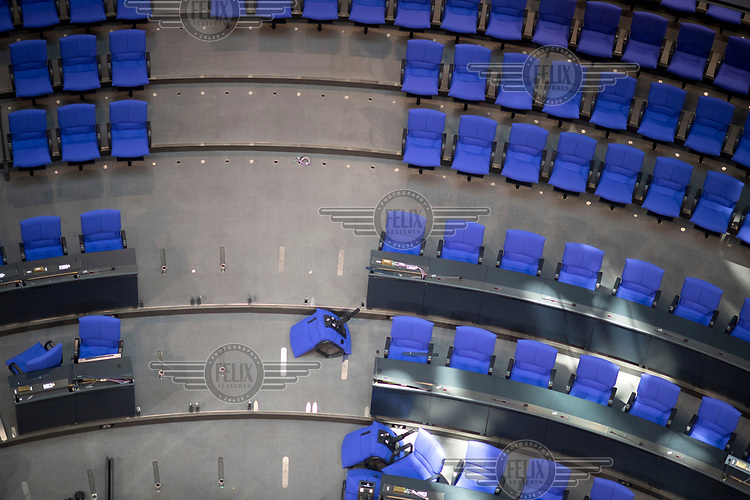 Workers at the Bundestag prepare the seating in the the plenary hall in advance of the upcoming session. Following German federal elections in 2017 the new Bundestag will have 709 members instead of 630.