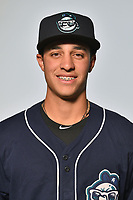 Asheville Tourists infielder Jose Gomez (4) poses for a photo at Story Point Media on April 4, 2017 in Asheville, North Carolina. (Tony Farlow/Four Seam Images)
