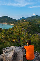 Thai girl sit on rocky cliff of John-Suwan viewpoint, Ko Tao island