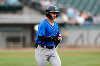 Biloxi Shuckers left fielder Mitch Longo (32) jogs to first base against the Tennessee Smokies on May 18, 2021, at Smokies Stadium in Kodak, Tennessee. (Danny Parker/Four Seam Images)