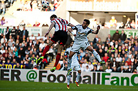 Saturday 19 October 2013 Pictured: ( L-R ) John O'Shea (captain) of Sunderland and Alvaro Vasquez jump for a ball <br /> Re: Barclays Premier League Swansea City vSunderland at the Liberty Stadium, Swansea, Wales