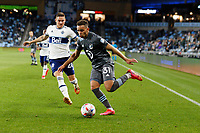 SAINT PAUL, MN - MAY 12: Hassani Dotson #31 of Minnesota United FC kicks the ball during a game between Vancouver Whitecaps and Minnesota United FC at Allianz Field on May 12, 2021 in Saint Paul, Minnesota.
