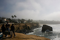 A group of surfers stopped to check our the surf next to the rock near the intersection of Sunset Cliffs Blvd and Froude Street where a peace sign stood for about eighteen months until it dissppeared mysteriously over the weekend on January 5 & 6, 2008.
