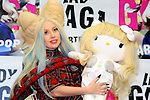 Lady Gaga, Dec 01, 2013 : Tokyo, Japan - Lady Gaga, an American pop music star, posed for photographs with Hallo Kitty, a Japanese popular character that was going to be put up for auction to raise money for people who were suffered by the Great East Japan Earthquake, at a press conference about her new album, ARTPOP, at Roppongi Hills, Roppongi, Minato, Tokyo, Japan on December 1, 2013. (Photo by Koichiro Suzuki/AFLO)