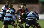 Munster number 8 Robin Copeland runs into trouble as the Blues defence of Gareth Davies, Dan Fish and Manoa Vosawai line up to stop him.<br /> Guiness Pro12<br /> Cardiff Blues v Munster<br /> Cardiff Arms Park<br /> 01.11.14<br /> ©Steve Pope-SPORTINGWALES