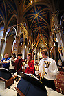 Handbell choir and celebration choir rehearse in the Basilica.
