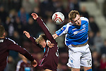 Hearts v St Johnstone.....05.03.13      SPL.Liam Craig gets above Fraser Mullen.Picture by Graeme Hart..Copyright Perthshire Picture Agency.Tel: 01738 623350  Mobile: 07990 594431