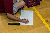 MR / Schenectady, NY. Zoller Elementary School (urban public school). Kindergarten inclusion classroom. Gym teacher records student's score on physical education assessment. MR: Mel16. ID: AM-gKw. © Ellen B. Senisi.