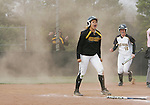 CHAD PILSTER · Hays Daily News<br /> <br /> Fort Hays State University's Adara Erickson (10) slides in to score the winning run as Katlyn Kern (12) celebrates on Friday, April 5, 2013, at Tiger Stadium at Fort Hays State University in Hays, Kansas. Fort Hays State University beat Missouri Western State University in the first game of a double header 12 innings 2-1.