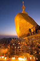 Pilgrims worshiping at the Golden Rock - Myanmar - at sunset