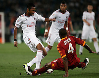 Calcio, Serie A: Roma-Milan. Roma, stadio Olimpico, 7 maggio 2011..Football, Italian serie A: AS Roma vs AC Milan. Rome, Olympic stadium, 7 may 2011..AC Milan forward Robinho, of Brazil, left, is tackled by AS Roma defender Juan, also of Brazil..UPDATE IMAGES PRESS/Riccardo De Luca