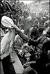 Summer '99-- Jakarta, Indonesia -- Angry citizens burn the Golkar flag in the streets, during the campaigning period.  President Suharto was a member of Golkar..