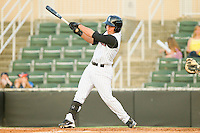 Drew Lee #11 of the Kannapolis Intimidators follows through on his swing against the Delmarva Shorebirds at Fieldcrest Cannon Stadium on May 20, 2011 in Kannapolis, North Carolina.   Photo by Brian Westerholt / Four Seam Images