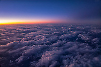 Clouds from the air over the Pacific Ocean.with sunset