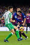 Lionel Andres Messi of FC Barcelona (R)  fights for the ball with Marc Bartra Aregall of Real Betis during the La Liga 2018-19 match between FC Barcelona and Real Betis at Camp Nou, on November 11 2018 in Barcelona, Spain. Photo by Vicens Gimenez / Power Sport Images