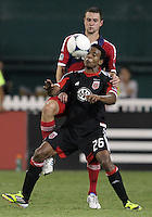 WASHINGTON, DC. - AUGUST 22, 2012:  Lionard Pajoy (26) of DC United shields the ball from  Daniel Paladini (11) of the Chicago Fire during an MLS match at RFK Stadium, in Washington DC,  on August 22. United won 4-2.