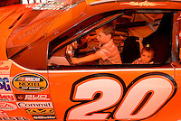 Young fans (no model releases) test out a show car during the 2007 Speed Street festival. For several days leading up to the May races at the Lowe's Motor Speedway, uptown Charlotte streets are transformed into a showcase of motor sports and non-stop entertainment. ..Photo taken in 2007. Photographer also has images from 2008.