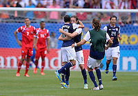 Chicago, IL - Sunday July 28, 2013:   United States forward Landon Donovan (10)  celebrates with teammate Mix Diskerud after defeating Panama by the score of 1-0 during the CONCACAF Gold Cup Finals soccer match between the USMNT and Panama, at Soldier Field in Chicago, IL.