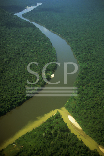 Amazon Basin, Brazil. Mucajai river with silt-bearing tributary; Roraima.