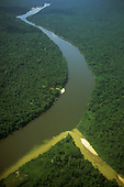 Amazon Basin, Brazil. Mucajai river with silt-bearing tributary; Roraima.