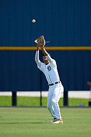 FCL Tigers West outfielder Carlos Pelegrin (33) catches a fly ball during a game against the FCL Yankees on July 31, 2021 at Tigertown in Lakeland, Florida.  (Mike Janes/Four Seam Images)