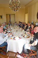 group of people enjoying a meal chateau la dauphine fronsac bordeaux france