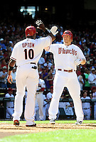 Apr. 5, 2010; Phoenix, AZ, USA; Arizona Diamondbacks third basman Mark Reynolds (right) is congratulated by teammate Justin Upton after hitting a two run home run in the fourth inning against the San Diego Padres during opening day at Chase Field. Mandatory Credit: Mark J. Rebilas-