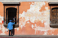 Antigua, Guatemala.  Two Painters Paint Grillwork of an Old House.