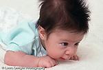 7 week old newborn baby boy on stomach holding head up closeup horizontal
