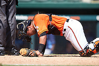 Baltimore Orioles catcher Daniel Fajardo (14) grimaces in pain after being hit during an Instructional League game against the Tampa Bay Rays on September 19, 2016 at Ed Smith Stadium in Sarasota, Florida.  (Mike Janes/Four Seam Images)
