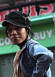 A young woman sits on the back of  a motorbike in the early morning on Bui Vien Street in Ho Chi Minh City, Vietnam. Aug. 18, 2011.