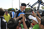 Sky Procycling riders Davide Appollonio (ITA) and Christian Knees (GER) sign autographs for local school children before the start of the 3rd Stage of the 2012 Tour of Qatar running 146.5km from Dukhan Souq, Dukhan to Al Gharafa, Qatar. 7th February 2012.<br /> (Photo Eoin Clarke/Newsfile)