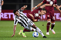 Alex Sandro of Juventus FC and Sasa Lukic of Torino Calcio compete for the ball during the Serie A 2021/2022 football match between Torino FC and Juventus FC at Stadio Olimpico Grande Torino in Turin (Italy), October 2nd, 2021. Photo Federico Tardito / Insidefoto