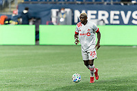 FOXBOROUGH, MA - OCTOBER 7: Chris Mavinga #23 of Toronto FC brings the ball forward during a game between Toronto FC and New England Revolution at Gillette Stadium on October 7, 2020 in Foxborough, Massachusetts.