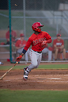 AZL Angels center fielder D'Shawn Knowles (20) follows through on his swing during an Arizona League game against the AZL Giants Black at the San Francisco Giants Training Complex on July 1, 2018 in Scottsdale, Arizona. The AZL Giants Black defeated the AZL Angels by a score of 4-2. (Zachary Lucy/Four Seam Images)