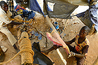 BURKINA FASO , Fada N´Gourma, village TINDANGOU, gold mining Camp PAMA, artisanal gold mines, boy ISSAKA ZONGO, 10 years old, must ventilate manually the pit mine with fresh air