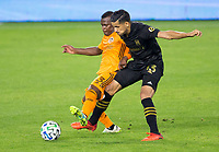 CARSON, CA - OCTOBER 28: Darwin Quintero #23 of the Houston Dynamo battles with Mohamed El-Munir #13 of LAFC during a game between Houston Dynamo and Los Angeles FC at Banc of California Stadium on October 28, 2020 in Carson, California.