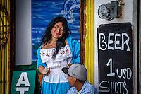 Urban Street Photograph of a beautiful señorita taken in Puerto Vallarta, Mexico.