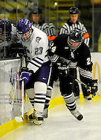 30 December 2007: Holy Cross Crusaders' defenseman Marty Dams, a Junior from Manotick, Ontario, battles Western Michigan University Broncos' Cam Watson at Gutterson Fieldhouse in Burlington, Vermont. The teams skated to a 1-1 tie, however the Broncos took the consolation game in a 2-0 shootout to win the third game of the Sheraton/TD Banknorth Catamount Cup Tournament...Mandatory Photo Credit: Ed Wolfstein Photo