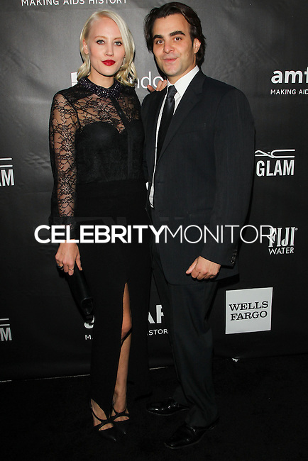 HOLLYWOOD, LOS ANGELES, CA, USA - OCTOBER 29: Annette Nyseth, Nicholas Jarecki arrive at the 2014 amfAR LA Inspiration Gala at Milk Studios on October 29, 2014 in Hollywood, Los Angeles, California, United States. (Photo by Celebrity Monitor)