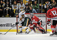 19 January 2008: Northeastern University Huskies' goaltender Brad Thiessen, a Sophomore from Aldergrove, British Columbia, makes a save as University of Vermont Catamounts' forward Brayden Irwin, a Sophomore from Toronto, Ontario, tries to get the rebound during a game at Gutterson Fieldhouse in Burlington, Vermont. The Catamounts defeated the Huskies 5-2 to close out their 2-game weekend series.
