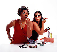 Women putting on make-up<br />