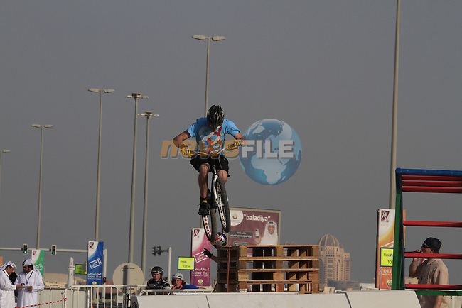 Trick riders entertain at the finish of Stage 1 of the Tour of Qatar 2012 running from Umm Slal Mohammed to Doha Golf Club, Doha, Qatar. 5th February 2012.<br /> (Photo by Eoin Clarke/NEWSFILE).