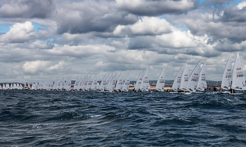 Liam Glynn (third from right) starts a yellow fleet race at the 2021 ILCA Vilamoura European Continental qualifier for the mens Olympic single-handed dinghy in Portugal