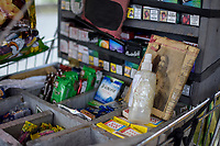 ARMENIA - COLOMBIA, 21-06-2021: Detalle de la botella de alcohol desinfectante, es visto en el puesto de Don Torres, vendedor ambulante quien sigue trabajando en medio de la pandemia de coronavirus en Bogotá, Colombia. Según el último informe oficial del Ministerio de Salud y Protección Social, Colombia registra 99.934 víctimas del COVID-19. Con más de 500 fallecidos en las últimas 24 horas el país espera llegar a las 100.000 víctimas hoy. / Detail of the bottle of disinfectant alcohol, is seen iat DonTorres' stall, street vendor, who continues working amid the coronavirus pandemic in Bogotá, Colombia. According to the latest official report from the Ministry of Health and Social Protection, Colombia registers 99,934 victims of COVID-19. With more than 500 deaths in the last 24 hours, the country expects to reach 100,000 victims today. Photo: VizzorImage / Santiago Castro / Cont