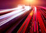 Artistic abstract traffic light trails. Busy highway traffic on a misty night, Highway 401, Toronto, Ontario, Canada.