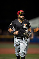 Salem-Keizer Volcanoes first baseman Robinson Medrano (7) jogs off the field between innings of a Northwest League game against the Hillsboro Hops at Ron Tonkin Field on September 1, 2018 in Hillsboro, Oregon. The Salem-Keizer Volcanoes defeated the Hillsboro Hops by a score of 3-1. (Zachary Lucy/Four Seam Images)