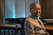 Tun Mahathir Mohamad, Malaysia's former prime minister, reacts to a question during an interview in his office in the iconic Petronas Twin Towers in Kuala Lumpur, Malaysia, on Thursday, Feb. 25, 2016.